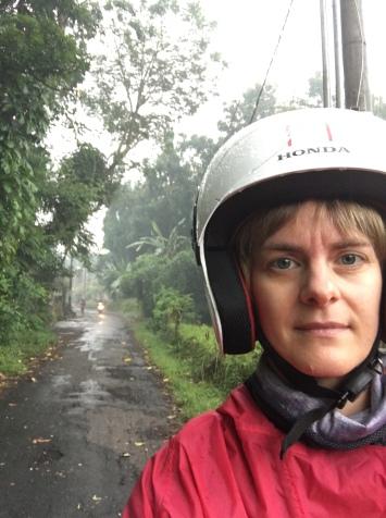 Wearing a scooter helmet in the rain