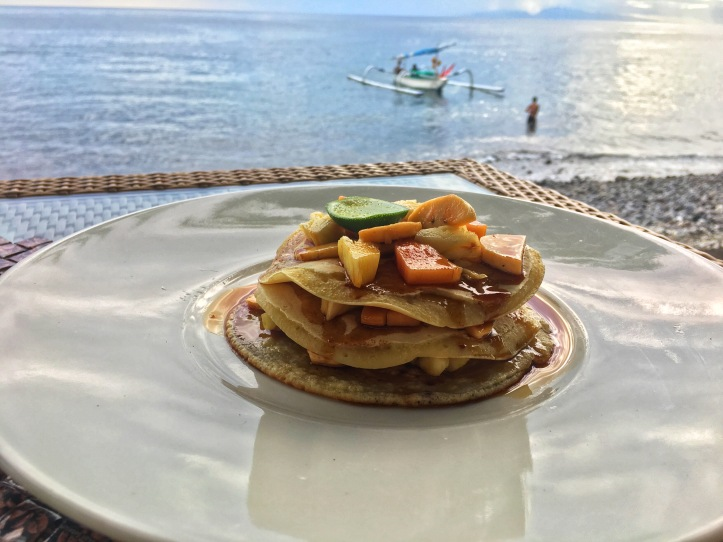 Thai pancakes with fresh fruit and syrup