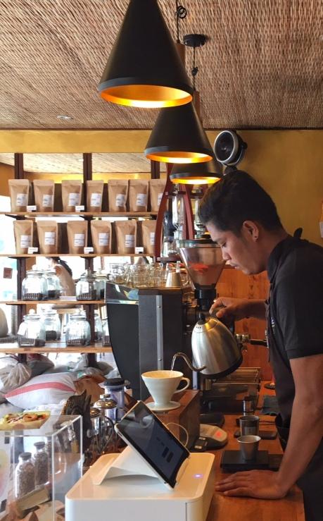 Baristas preparing a coffee